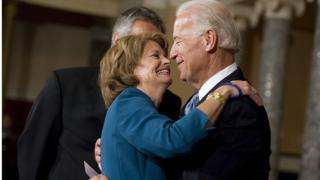 Joe Biden shares an embrace with Republican Senator Lisa Murkowski in the Senate chamber
