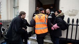 People leaving the £15 million Grade II listed mansion on Belgrave Place