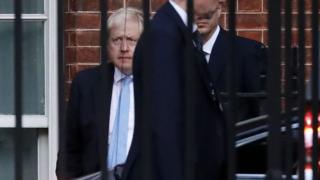 Prime Minister Boris Johnson leaves from the rear of 10 Downing Street