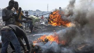 Men burning electronic waste in at the Agbogbloshi electronic waste site in Accra, Ghana - Monday 27 August 2018
