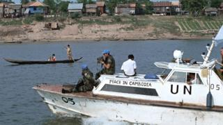 Troops from UNTAC (the United Nations Transitional Authority in Cambodia) patrol the rivers that course through the capital as they prepare the country for elections