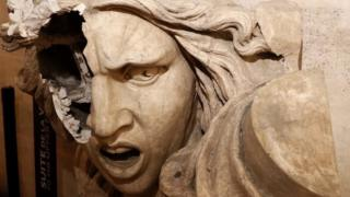 A vandalised statue of Marianne, a symbol in France, seen inside the Arc de Triomphe after Paris riots