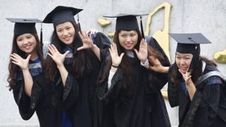 Chinese women pose for graduation photo