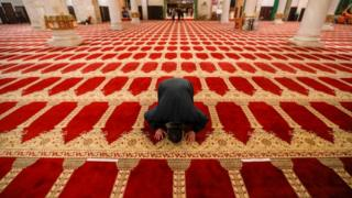 A Palestinian man performs the morning prayer inside the Al-Aqsa mosque