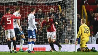 Les joueurs de Manchester United jubilent après un but marqué contre Wigan