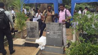 The press were allowed to photograph the grave after the body was removed