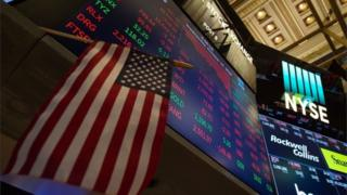 Signs on trading NYSE trading floor