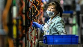 A woman works in Everwin precision technology factory in Dongguan, Guangdong Province, China