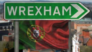 Wrexham sign and Portuguese
