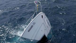 A tourist boat after it capsized off the coast in Phuket Island, southern Thailand