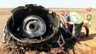 Egyptian investigators check debris from crashed Russian jet in the Sinai