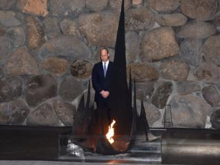 Prince William stands next to the eternal flame during a ceremony commemorating the six million Jews killed by the Nazis during the Holocaust, in the Hall of Remembrance at Yad Vashem World Holocaust Remembrance Center in Jerusalem