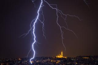Fatih Mosque is seen as lightning strikes over the Istanbul skyline during a thunderstorm, Turkey