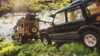 in_pictures Model Land Rovers by a river
