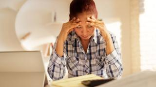 Distressed woman filling in form (file image)