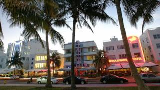Renovated hotel buildings overlooking Ocean Drive are adorned by neon lights in the early evening 26 September 2006.