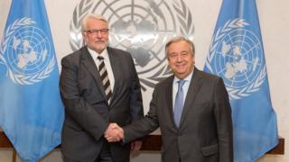 "In this photo provided by the United Nations on Monday Jan. 9, 2017, U.N. Secretary-General Antonio Guterres, right, and Poland""s Minister for Foreign Affairs Witold Waszczykowski, left, pose for a handshake during their meeting at U.N. headquarters."