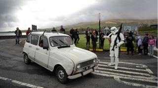 A Stormtooper stops a car