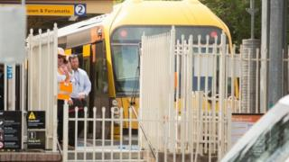Railway officials stand next to a train that crashed in Sydney