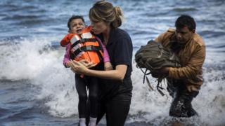 A Syrian child is rescued from a dinghy in Greece