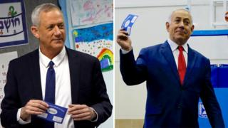 Benny Gantz (L) and Benjamin Netanyahu (R) vote in Israel's general election (9 April 2019)