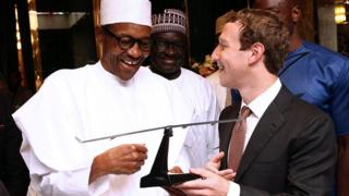 Nigeria's President Muhammadu Buhari receiving a gift from Mark Zuckerberg in Abuja, Nigeria - Friday 2 September 2016