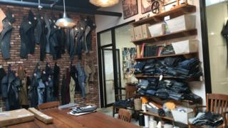 Sample of jean designs on display at Denim North America