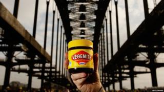 Vegemite jar held up under the Sydney Harbour Bridge Getty Images