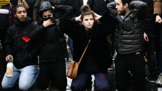 High school students re-enact yesterday's student arrest in Mantes-la-Jolie during a demonstration at the place de la Republique in Paris, 7 December 2018