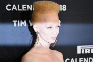 Thando Hopa is lit up on the catwalk.