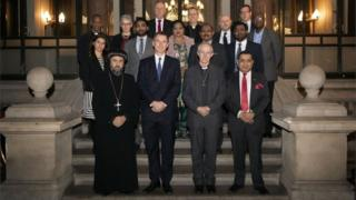 Foreign Minister Jeremy Hunt (first row, second from left), Archbishop of Canterbury Justin Welby (first row, second right) is supported by other Christian leaders, including Archbishop Angaelos of the Coptic Orthodox Church of Britain (left) and dignitary and Politicians with survivors of Christian persecution