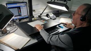 Person digitising archives at Yad Vashem