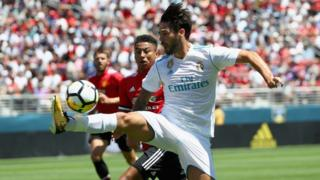 Isco of Real Madrid controls the ball in front of Jesse Lingard of Manchester United during the International Champions Cup match at Levi's Stadium on July 23, 2017 in Santa Clara, California