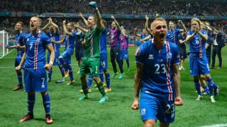 Players of Iceland celebrate after they defeated England