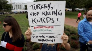 donald trump latest news Protesters against Turkey's cross-border offensive in northern Syria wave signs outside the White House in Washington DC