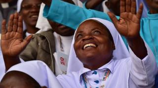 A nun reacts at Namugongo Martyrs' Shrine during an open air mass held by Pope Francis on November 28, 2015