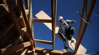 A worker carries lumber as he builds a new home on January 21, 2015 in Petaluma, California. According to a Commerce Department report, construction of new homes increased 4.4 percent in December, pushing building of new homes to the highest level in nine years