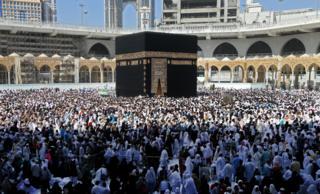 Muslim pilgrims walk around the Kaaba (Tawaf al-Wadaa), Islam's holiest shrine, at the Grand Mosque in Saudi Arabia's holy city of Mecca on 27 February 2020.