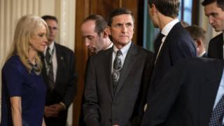 White House national security adviser Michael Flynn (C).