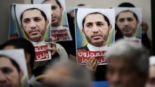 Wefaq supporters hold up posters of Sheikh Ali Salman at a protest in Zinj, Bahrain (29 May 2016)