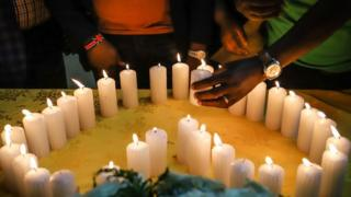 Relatives of Kenyan victims light candles arranged in a heart shape during a memorial service at the Kenyan Embassy in Addis Ababa on 16 March 2019.