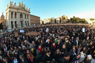 "People take part in the ""Sardine Movement"" rally in Rome, 14 December"