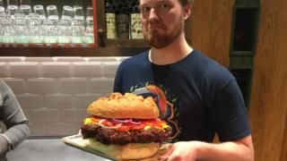 Andrey Sidorov holding a giant 5kg burger.