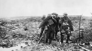A stretcher party struggle in the mud during the battle of Passchendaele