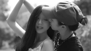 Ou (right) and girlfriend Yi