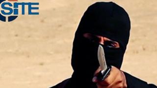 Mohammed Emwazi, holding a knife