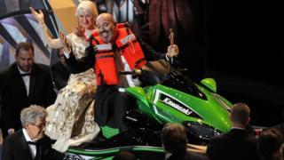 Mark Bridges and Dame Helen Mirren on a jet ski at the Oscars