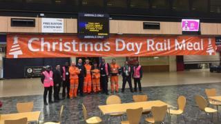 Volunteers standing in Euston Station