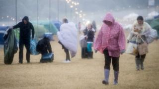 Wet festival-goers at Camp Bestival