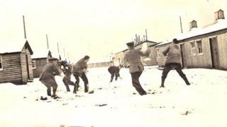 German soldiers having a snowball fight